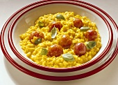Risotto alla milanese with cherry tomatoes (Italy)