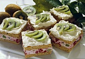 Fruit slices with kiwi fruit; raspberries & cream