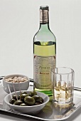 A Bottle of Retsina with Olives