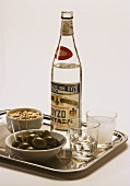 A Bottle of Ouzo; Anise Liqueur with Olives