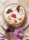 Decorated spring cake; posy of violets