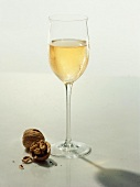 A Glass of White Wine with Walnut and Shell