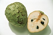 Whole and half cherimoya