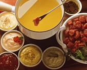 Meat fondue with various dips