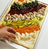 Arranging mixed vegetable flan