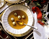Yellow boletus consomme with marrow dumplings