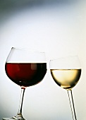 Chinking red and white wine glasses
