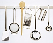 Several Kitchen Tools Hanging on Rack