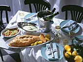 Fish Dinner with Place Settings and Wine
