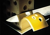 Slicing Dutch Leerdamer Cheese