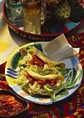 Tacos with mozzarella & lettuce filling & spicy tomato sauce