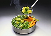 Steamer tray with steamed vegetables