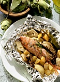 Triglia al cartoccio (red mullet cooked in foil, Italy)