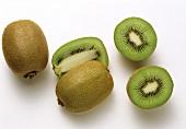 Whole and halved kiwi fruit