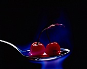 Flamed Cherries on a spoon