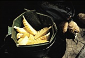 Peeled and Cut Pineapple in a Leaf Bowl