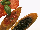 Crostini with tomatoes and olive paste (Tuscany, Italy)