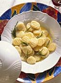 Gnocchi conditi (potato dumplings with rosemary, Italy)