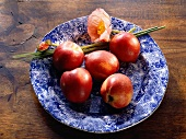 Five Whole Nectarines on Blue Plate