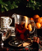 Mulled Wine in Glass Pitcher with Lemon Peel