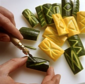 Cutting patterns in courgettes with a lino knife