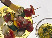Brushing Olive Oil onto Meat Skewers