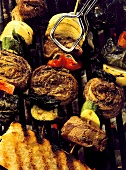Meat Skewers on Grill with Vegetables