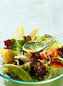 Pouring Vinaigrette Dressing Over a Tossed Salad