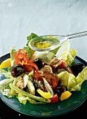 Tuna Salad with Spoon of Salad Dressing; Salad Nicoise