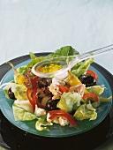 Pouring Vinaigrette Sauce over Tuna Salad