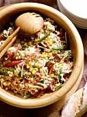 Hungarian Rice Salad in a wooden Bowl