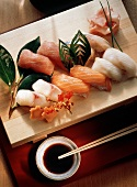 Sushi Platter with Leaves and Chopsticks