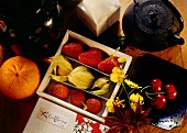 Assorted fruit in small box, with decoration
