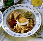 Classic Labskaus (potatoes, meat, herrings, beetroot, egg)