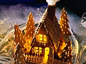 Decorated and Glowing Gingerbread House with Trees