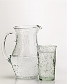 A glass of mineral water and jug