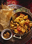 Rice, lentil and vegetable stew and poppadoms