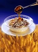 Pouring Honey over Raspberry Muesli