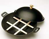 Cast iron wok with wooden insert