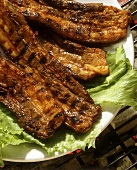 Barbecued ribs on bed of lettuce