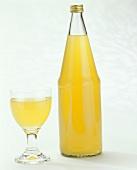A Bottle of Orange Juice & a Glass