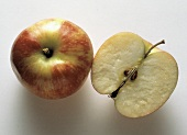 Two Red Delicious; Half and Whole