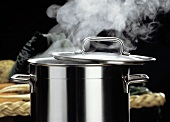 A Steaming Metal Pot; Lid Ajar