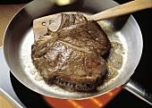 Porterhouse Steak Frying in a Skillet