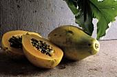 Two Papaya; One Whole; One Halved