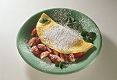 Strawberry omelette with icing sugar