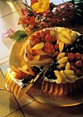 Summery peach and berry flan