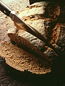 Rye bread being sliced