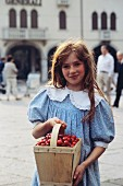 Young Girl with a Basket of Cherries