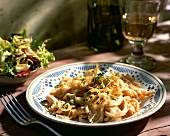 Noodles (Spaetzle) with onions and a mixed salad